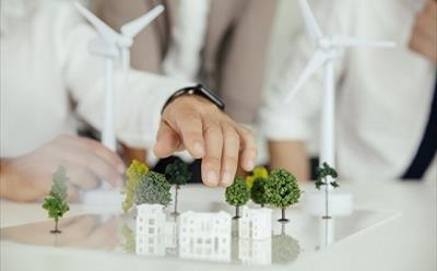 Close-up of business people wind turbine model