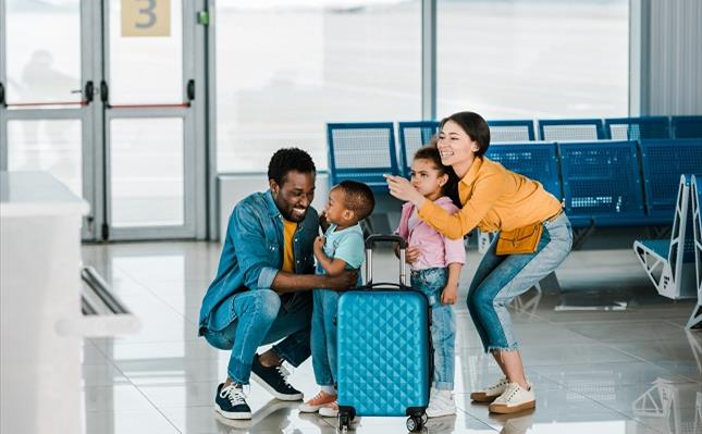 Smiling african american family with kids in airport