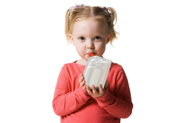 Girl drinking from pouch